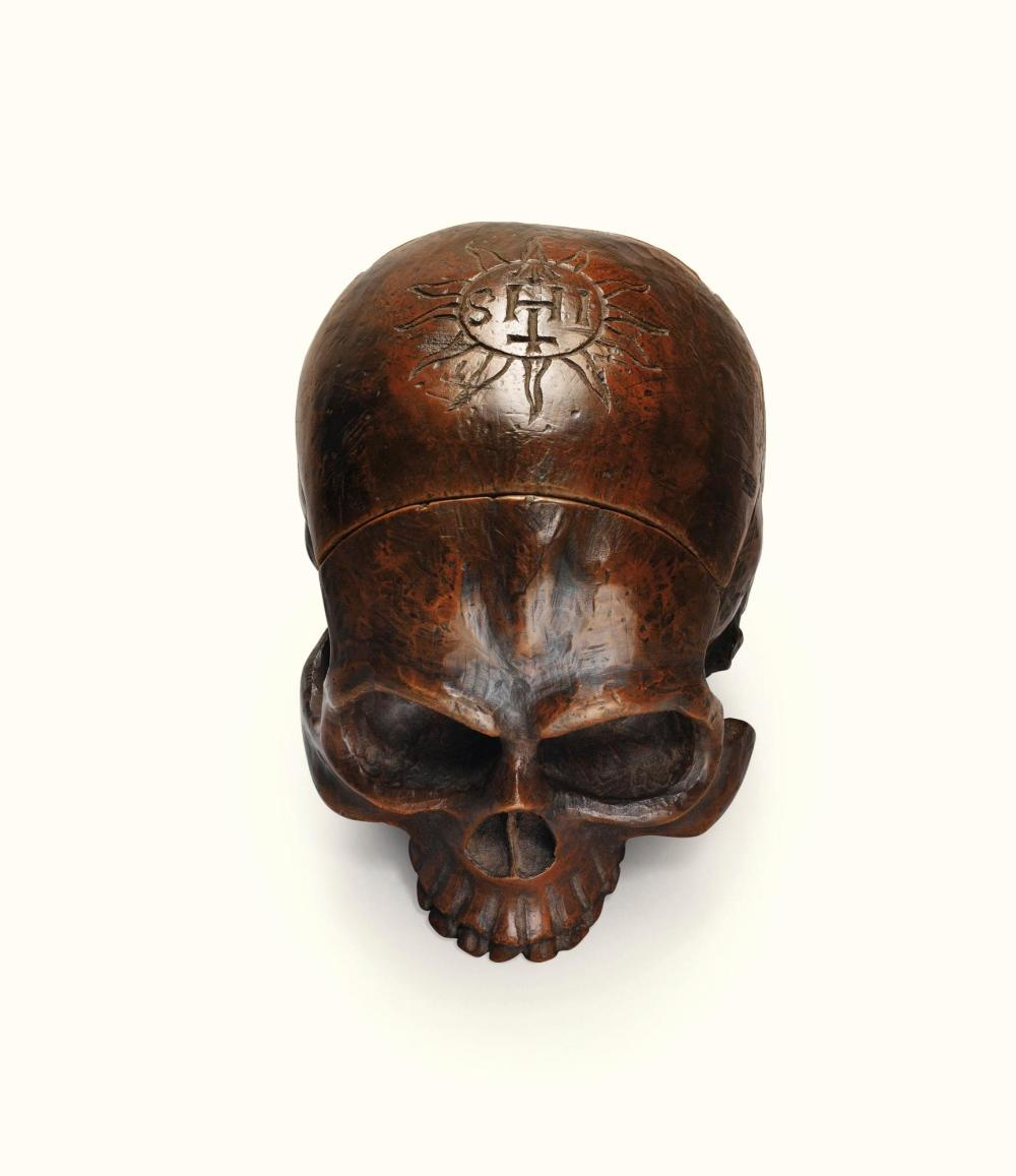 A GERMAN CARVED WOOD SKULL-SHAPED SUNDIAL, 17TH CENTURY |