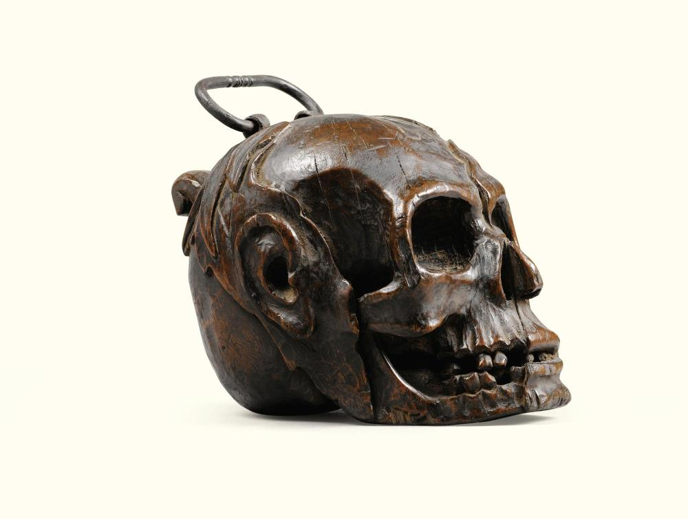 TWO GERMAN CARVED WOOD SKULLS, ONE LATE 17TH CENTURY, THE OTHER 19TH CENTURY |
