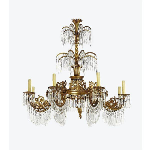 A German neoclassical gilt-metal, giltwood and cut-glass eight-light chandelier, after a design by Karl Friedrich Schinkel circa 1835