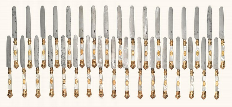 A SET OF THIRTY-FOUR SILVER-GILT AND MOTHER-OF-PEARL DESSERT KNIVES, NICHOLLS & PLINCKE, ST PETERSBURG, 1840 |