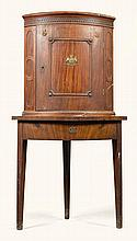 A GERMAN MAHOGANY CORNER CUPBOARD ON STAND, WESTPHALIA EARLY 19TH CENTURY |