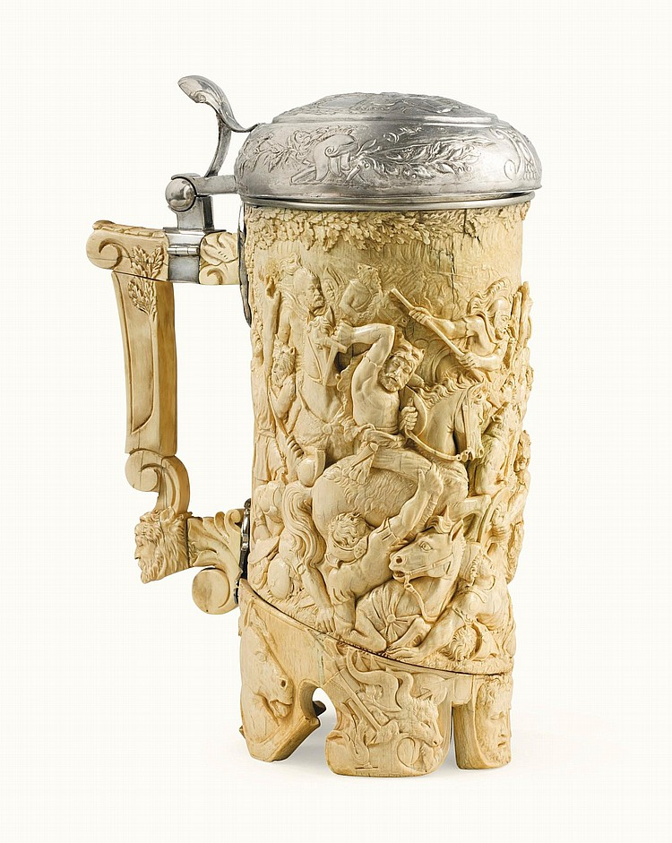AN IVORY TANKARD WITH SILVER MOUNTS, PROBABLY GERMAN, LATE 19TH CENTURY |