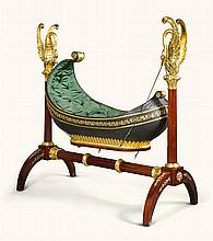 A GERMAN EMPIREGILT BRASS MOUNTED, GREEN-PAINTED MAHOGANY AND CARVED GILTWOOD ROCKING CRADLE PROBABLY LEIPZIG, CIRCA1825  