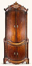 A NORTH GERMAN CARVED MAHOGANY CORNER CUPBOARD, PROBABLY BREMEN CIRCA 1760 |