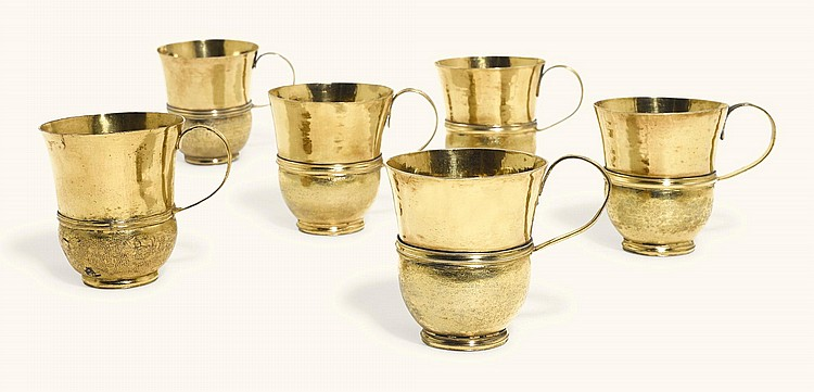 A SET OF SIX WILLIAM III SILVER-GILT TOT CUPS, TWO MAKER'S MARK NL (JACKSON, 1989, P. 146, LINE 12, LONDON, 1695, THE REMAINDER UNMARKED |