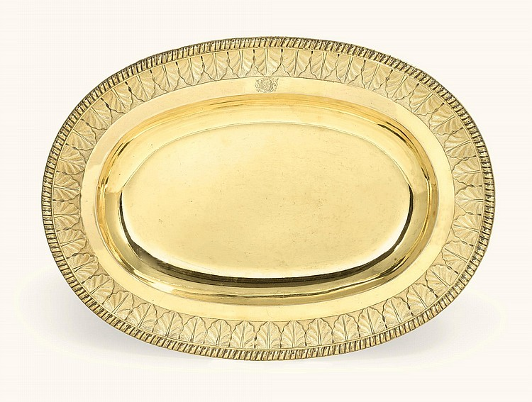 A SILVER-GILT DISH, UNMARKED, PROBABLY ENGLISH, CIRCA 1730 |