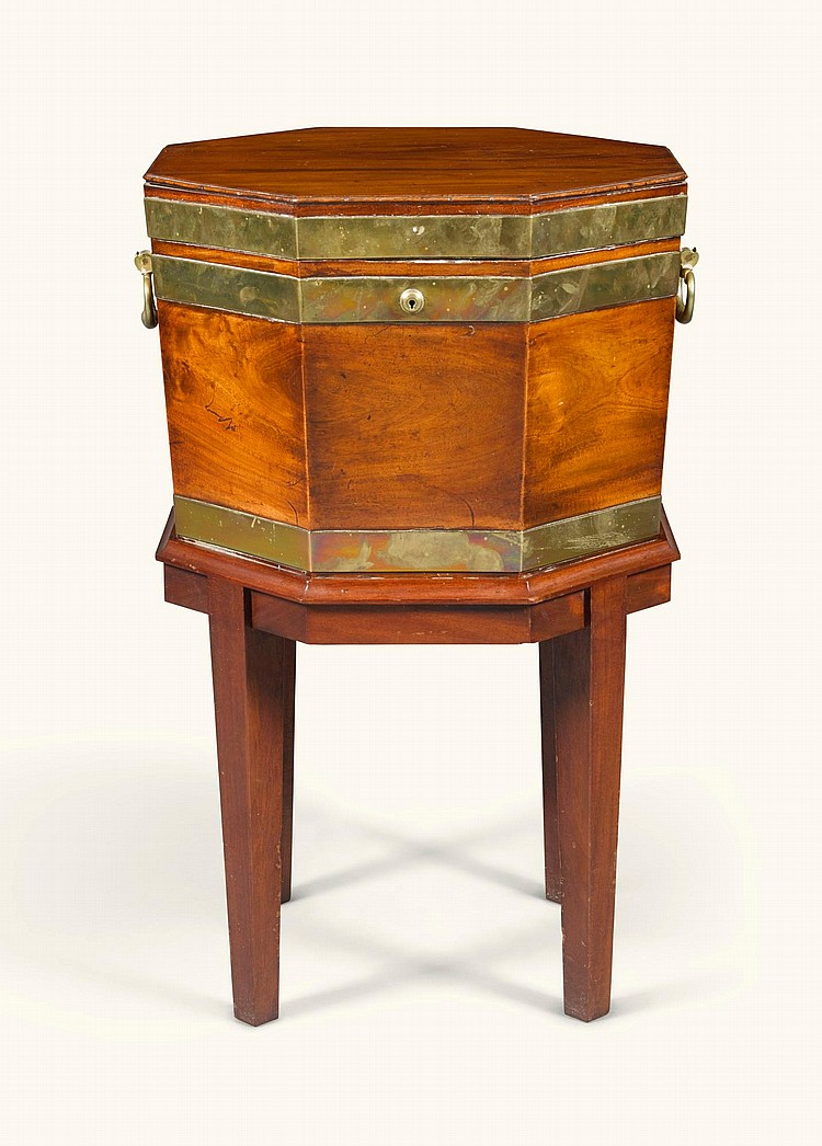 A GEORGE IIIOCTAGONAL BRASS-BOUND MAHOGANY CELLARET, CIRCA 1800 |