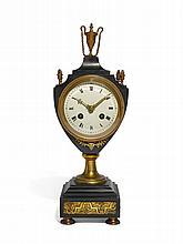 AN EMPIRE GILT-MOUNTED BLACK MARBLE MANTEL CLOCK, CIRCA 1800  