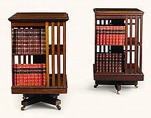 TWOEDWARDIAN REVOLVING CROSSBANDED MAHOGANYBOOK TABLES, CIRCA 1905  