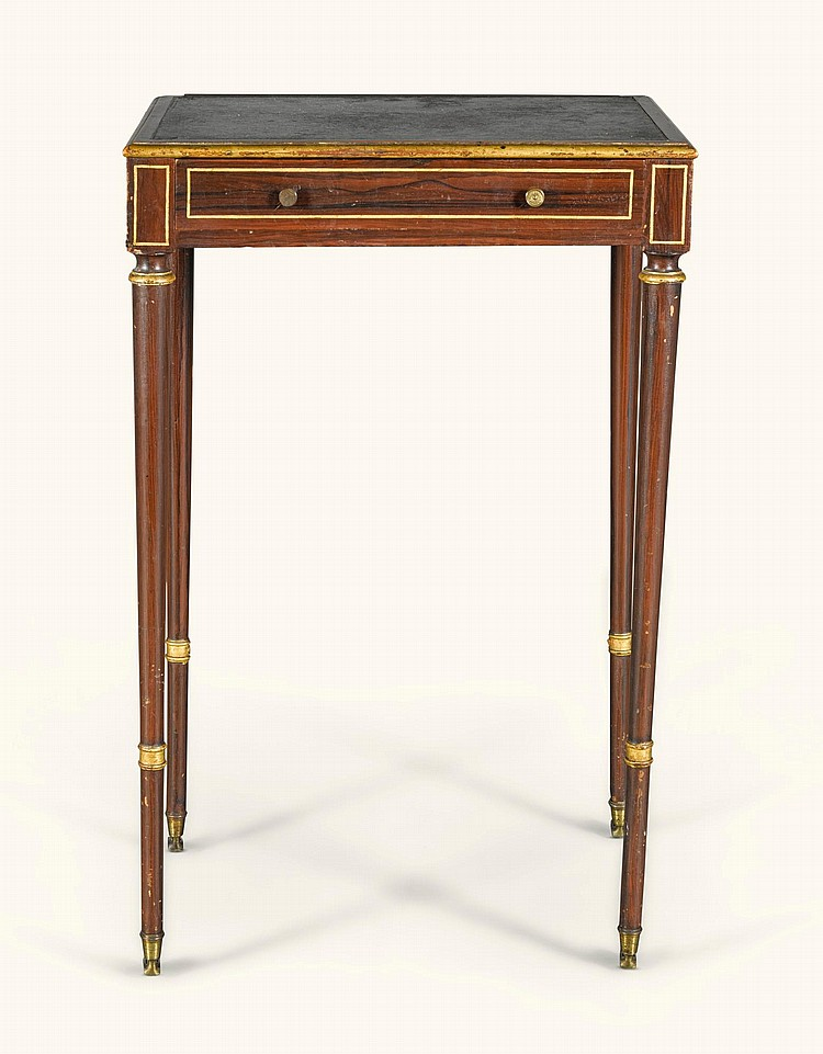 A REGENCY SIMULATED ROSEWOOD AND PARCEL-GILT WRITING TABLE, CIRCA 1810 |