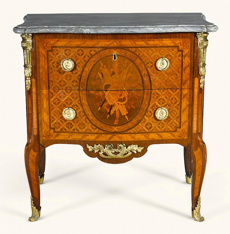 A TRANSITIONAL GILT-BRONZE MOUNTED TULIPWOOD ANDFRUITWOOD MARQUETRY PETIT-COMMODE BY GUILLAUME KEMP, CIRCA 1770 |
