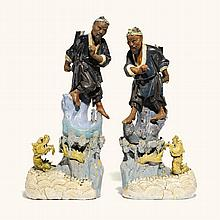 A PAIR OF CHINESE STONEWARE FIGURES ON BASES<BR>GUANGDONG, CIRCA 1900 |