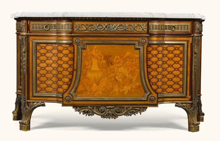 A LOUIS XVI STYLE GILT-BRONZE MOUNTED FRUITWOOD AND AMARANTH MARQUETRY AND PARQUETRY COMMODE AFTER THE MODEL BY RIESENER LATE 19TH CENTURY |