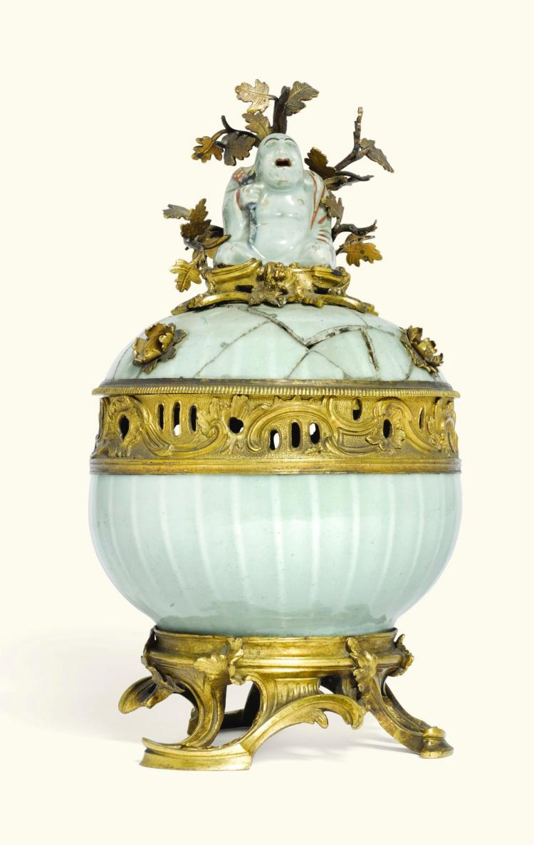 A LOUIS XV STYLE GILT-BRONZE MOUNTED CHINESE CELADON LOBED POT-POURRI BOWL AND PIERCED COVER, THE PORCELAIN QIANLONG PERIOD, THE MOUNTS 19<SUP>TH</SUP> CENTURY |