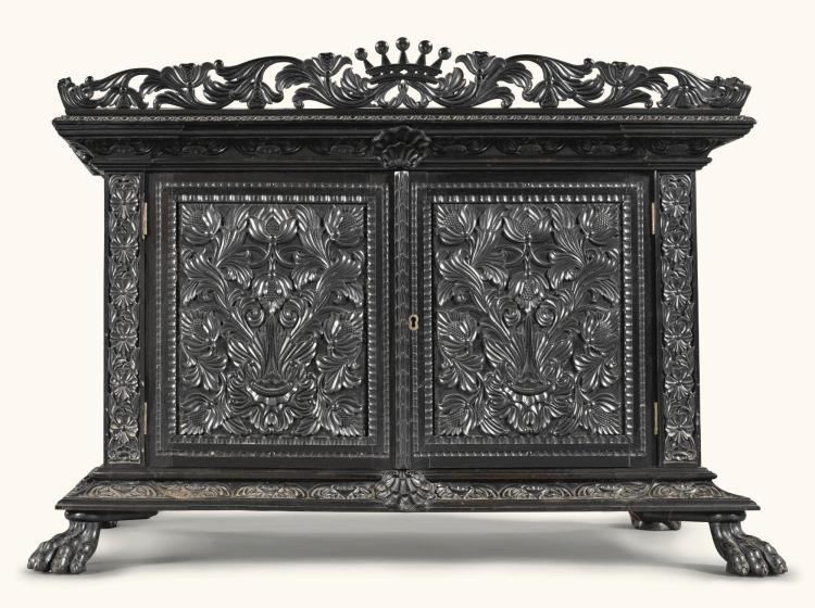 A LARGE CEYLONESE CARVED EBONY TABLE CABINET, SRI LANKA, GALLE DISTRICT, MID-19TH CENTURY |