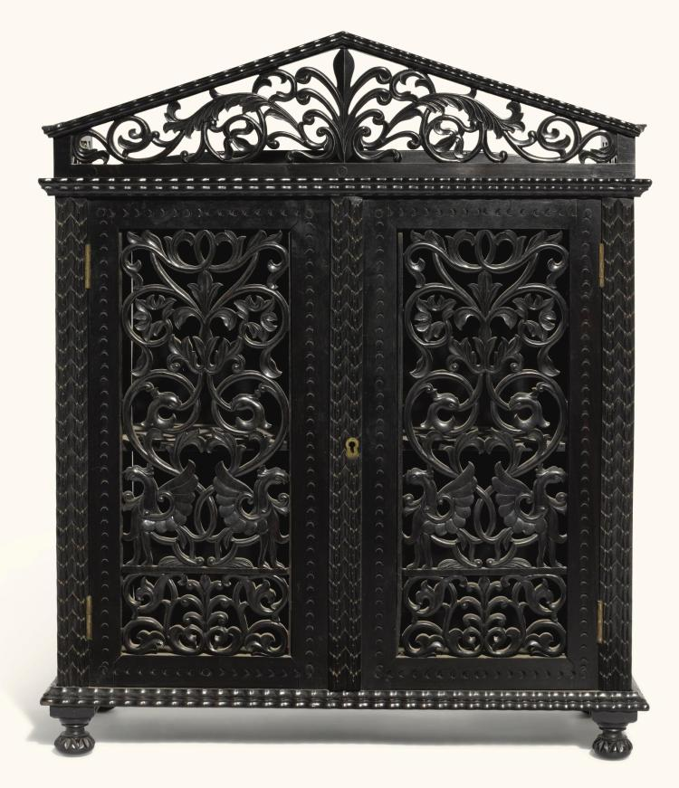 A CEYLONESE CARVED EBONY TABLE CABINET, SRI LANKA, GALLE DISTRICT, MID-19TH CENTURY |