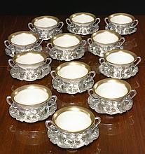 A SET OF TWELVE AMERICAN SILVER BOUILLON CUPS AND MATCHING SAUCERS, GORHAM MFG. CO., PROVIDENCE, RI, MARTELÉ, 1920 |