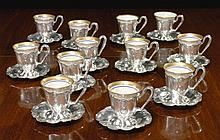 A SET OF TWELVE AMERICAN SILVER COFFEE CUPS AND MATCHING SAUCERS, GORHAM MFG. CO., PROVIDENCE, RI, 1920 |