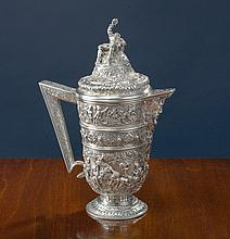 AN AMERICAN SILVER COVERED PITCHER WITH SIGNED CHASING, S. KIRK & SON, BALTIMORE, MD, CIRCA 1880-90 |
