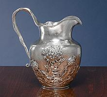 AN AMERICAN SILVER JAPANESE STYLE PITCHER, SIMPSON, HALL, MILLER & CO., WALLINGFORD, CT, CIRCA 1895 |