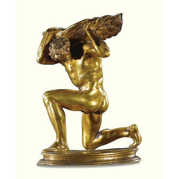 Italian, Venice, 16th century style After Girolamo Campagna (1549-1625) , A gilt bronze salt cellar in the form of a kneeling man with a shell on his back