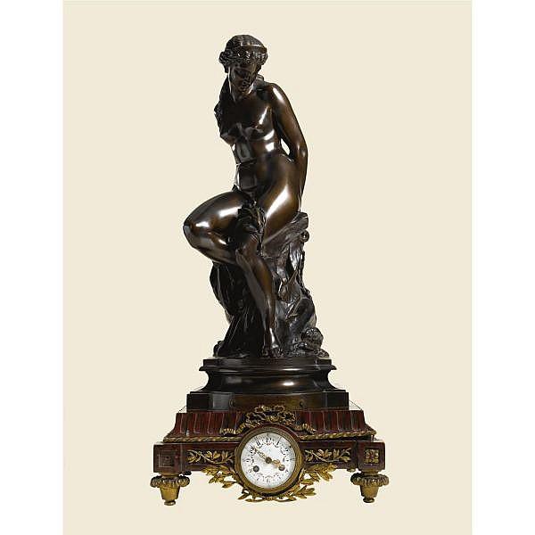 Alexandre-Pierre Schoenewerk , French 1820-1885 ANDROMEDA bronze, dark brown patina, raised on a rouge griotte marble and gilt-bronze timepiece pedestal