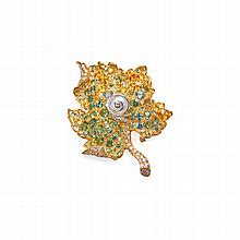 18 KARAT TWO-COLOR GOLD, CULTURED PEARL, DIAMOND AND COLORED SAPPHIRE LEAF BROOCH, CHRISTIAN DIOR, FRANCE