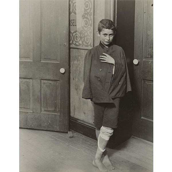 Lewis W. Hine , 1874-1940 'young boy living near hull house visits clinic, chicago'