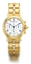 BREGUET | A YELLOW GOLD AUTOMATIC CHRONOGRAPH WRISTWATCH WITH DATE <br />REF 3944 CIRCA 1995