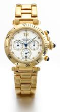 CARTIER | A YELLOW GOLD AUTOMATIC CHRONOGRAPH WRISTWATCH WITH DATE<br />REF 2111 PASHA CIRCA 1995