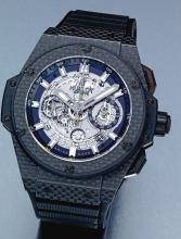 HUBLOT | A LARGE PVD-COATED CERAMIC AND TITANIUM SEMI-SKELETONIZED AUTOMATIC FLY BLACK CHRONOGRAPH WRISTWATCH WITH POWER RESERVE AND DATE<br />CASE 911752 UNICO CIRCA 2010