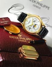 PATEK PHILIPPE | A FINE YELLOW GOLD AUTOMATIC PERPETUAL CALENDAR WRISTWATCHWITH MOON-PHASES <p>REF 3940 MVT 3125159CASE 4125906MADE IN 1995</p>