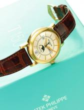 PATEK PHILIPPE | RETAILED BY TIFFANY & CO.: A LIMITED EDITION PINKGOLD AUTOMATIC ANNUAL CALENDAR WRISTWATCH WITH MOON PHASES<br />REF 5150 MVT 3235409 CASE 4171924 T150 MADE IN 2002