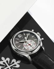 PATEK PHILIPPE | A FINE PLATINUM AUTOMATIC ANNUAL CALENDAR CHRONOGRAPH WRISTWATCH WITH REGISTERS, POWER RESERVE AND DAY/NIGHT INDICATION<br />REF 5960 MVT 3503176 CASE 4453608MADE IN 2008