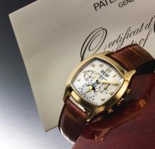 PATEK PHILIPPE | A VERYFINE AND RARE YELLOW GOLDCUSHION-FORM PERPETUAL CALENDAR CHRONOGRAPH WRISTWATCH WITH MOON PHASES AND REGISTERS<br />REF 5020 MVT 3047187 CASE 2956151MADE IN 2004