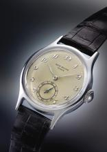 PATEK PHILIPPE | A FINE AND RARE STAINLESS STEEL WRISTWATCH WITH BREGUET NUMERALS<br />REF 565 MVT 963756CASE648597 MADE IN1949