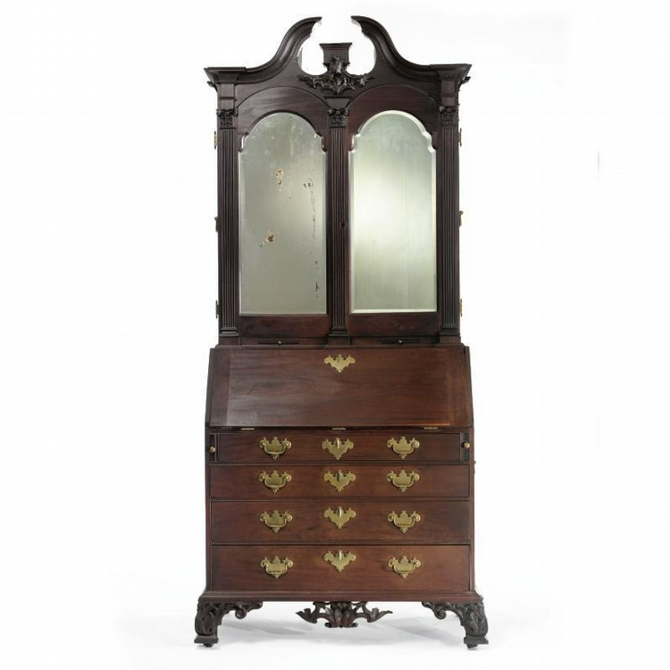 THE GILBERT DEBLOIS FAMILY IMPORTANT CHIPPENDALE CARVED AND FIGURED MAHOGANY DESK-AND-BOOKCASE WITH CARVING ATTRIBUTED TO JOHN WELCH, BOSTON, MASSACHUSETTS