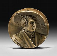 GEORG SCHWEIGGER (1613-1680)<BR />AFTER A MODEL ATTRIBUTED TO THE CIRCLE OF HANS SCHWARZ (1492-1550) <BR />GERMAN, NUREMBERG, MID-17TH CENTURY | Relief medallion with a portrait ofa young man
