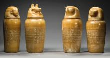 A SET OF FOUR EGYPTIAN BANDED ALABASTER CANOPIC JARS, 26TH DYNASTY, 664-525 B.C. | A Set of Four Egyptian Banded Alabaster Canopic Jars