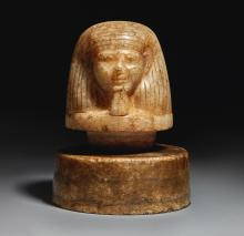 AN EGYPTIAN ALABASTER CANOPIC JAR LID, EARLY 18TH DYNASTY, CIRCA 1540-1400 B.C. | An Egyptian Alabaster Canopic Jar Lid