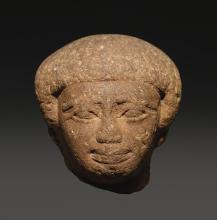 AN EGYPTIAN BROWN QUARTZITE HEAD OF A MAN, EARLY 12TH DYNASTY, PERIOD OF AMENEMHAT I/SESOSTRIS I, 1938-1875 B.C. | An Egyptian Brown Quartzite head of a Man