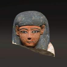 AN EGYPTIAN POLYCHROME LIMESTONE HEAD FROM AN USHABTI, 18TH DYNASTY, PERIOD OF TUTHMOSIS IV/AMENHOTEP III, 1400-1353 B.C. | An Egyptian Polychrome Limestone Head from an Ushabti