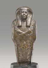 A FRAGMENTARY EGYPTIAN SERPENTINE USHABTI OF THE CHIEF LECTOR PRIEST PETAMENOPHIS, 25TH DYNASTY, REIGN OF TAHARQA/TANWETAMANI, 690-656 B.C. | A Fragmentary Egyptian Serpentine Ushabti of the Chief Lector Priest Petamenophis