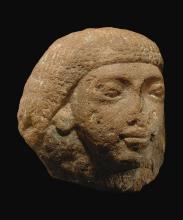 AN EGYPTIAN QUARTZITE HEAD OF A MAN, LATE 18TH/EARLY 19TH DYNASTY, CIRCA 1320-1280 B.C. | An Egyptian Quartzite Head of a Man