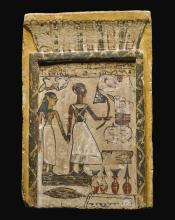 AN EGYPTIAN POLYCHROME LIMESTONE STELA, EARLY 12TH DYNASTY, CIRCA 1938-1850 B.C. | An Egyptian Polychrome Limestone Stela
