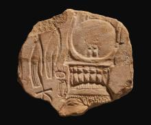 AN EGYPTIAN SANDSTONE RELIEF FRAGMENT, KARNAK, 18TH DYNASTY, EARLY IN THE REIGN OF AKHENATEN, CIRCA 1353-1345 B.C. | An Egyptian Sandstone Relief Fragment, Karnak