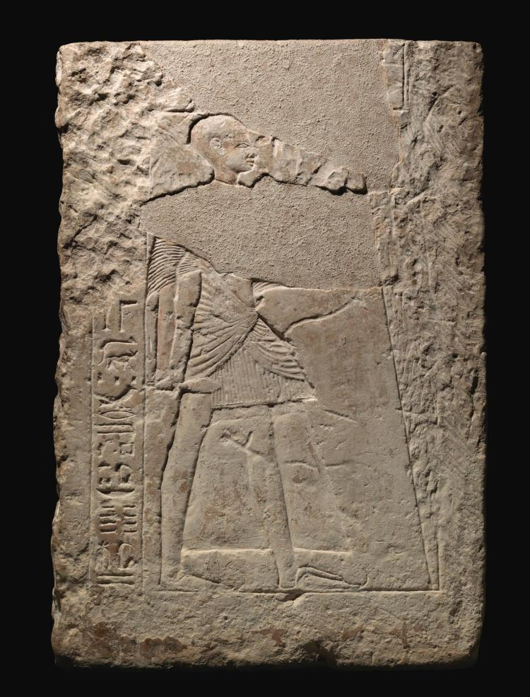 An egyptian limestone relief fragment th dynasty