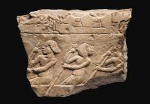AN EGYPTIAN LIMESTONE RELIEF FRAGMENT, AMARNA, 18TH DYNASTY, LATER IN THE REIGN OF AKHENATEN, CIRCA 1345-1336 B.C.   An Egyptian Limestone Relief Fragment, Amarna