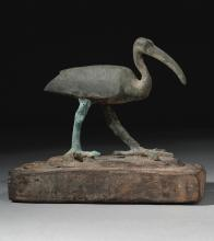 AN EGYPTIAN BRONZE FIGURE OF AN IBIS, LATE PERIOD, 716-30 B.C.   An Egyptian Bronze Figure of an Ibis