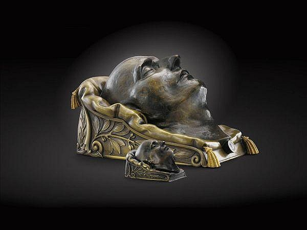 Francesco Antommarchi (1780-1838), masque mortuaire de Napoléon I er et un masque miniature France, 1833 , A French bronze Death Mask of Napoleon on a Cushion signed and dated 1833, and foundry mark Richard & Quenesl with a little mask signed by